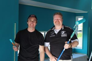 Richard House and Daniel Cowan completed the Patumahoe Primary School library paint job
